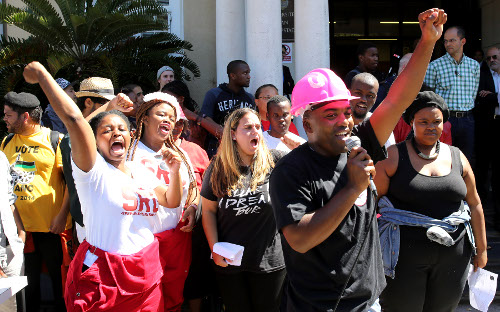 Students protest near the statue of Cecil John Rhodes at University of Cape Town on March 20, 2015. (Gallo)