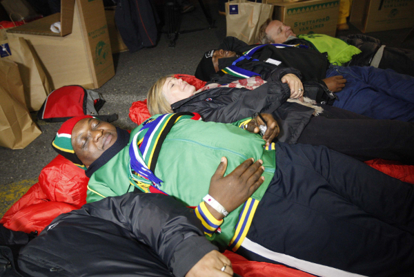 """Gauteng premier David Makhura, Tery Volkwyn and Parks Tau during the inaugural 702-Sun International """"CEO SleepOut"""" initiative on June 18 2015 in Johannesburg. (Gallo)"""