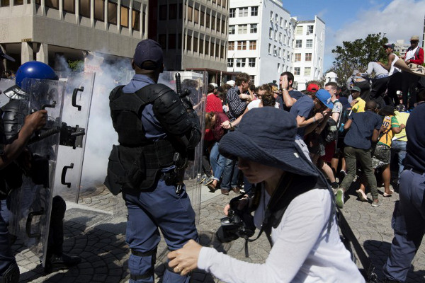 Students from the University of Cape Town clash with members of the South African Police Services after they forced their way into the South African Parliament in Cape Town on October 21, 2015. (AFP / Rodger Bosch)