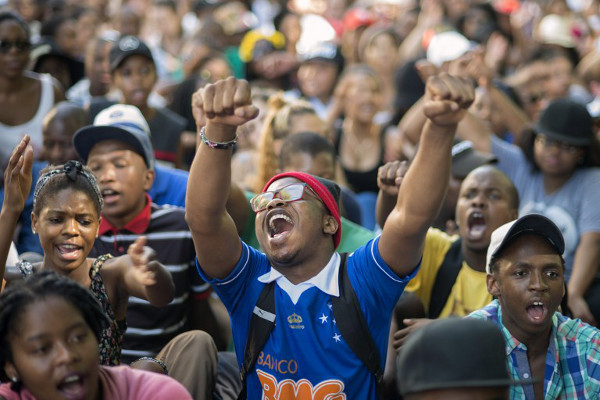 Students chant slogans during a protest against fee hikes at the University of Cape Town on October 20, 2015. AFP / Rodger Bosch