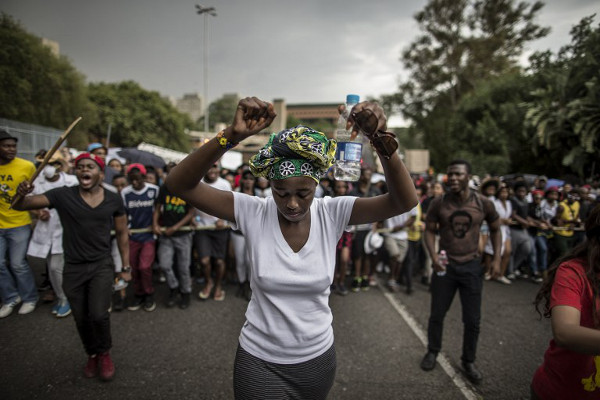 Students march through the campus of the University of the Witwatersrand in Johannesburg on October 21, 2015. (AFP / Marco Longari)