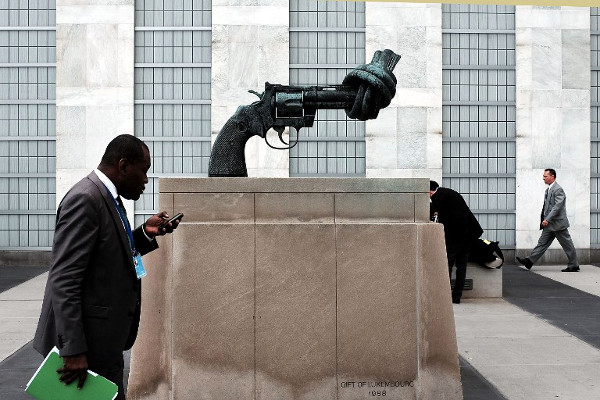 """Non-Violence"", a bronze sculpture by Swedish artist Carl Fredrik Reutersward of an oversized Colt Python .357 Magnum revolver with a knotted barrel and the muzzle pointing upwards, sits on the grounds of the United Nations on September 29, 2015 in New York City. (AFP)"