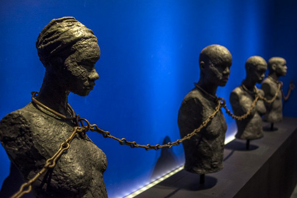 "A photo taken on May 8, 2015, shows a piece entitled ""Slave Chain with Four Yokes"" from the Dexue voodoo convent in Adounko, Benin, dating from the 19th century at the Memorial ACTe, the Caribbean Centre of Expression and Memory of Slavery and the Slave Trade, in Point-a-Pitre. (AFP / Nicolas Derne)"