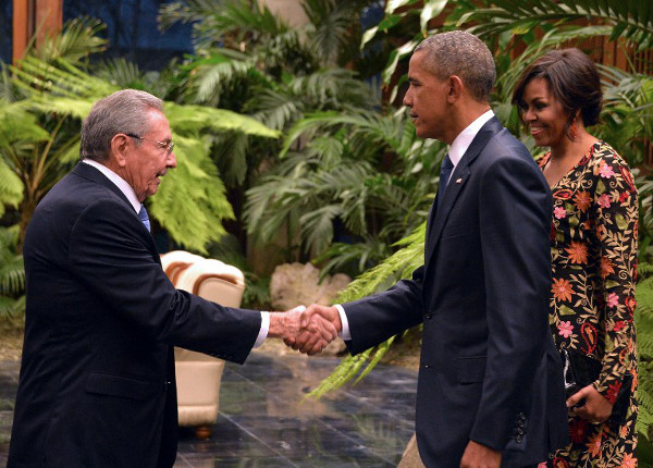 "Cuban President Raul Castro (L) shakes hands with US President Barack Obama next to US First Lady Michelle Obama (R), ahead of the state dinner at the Revolution Palace in Havana on March 21, 2016. Obama and Castro vowed Monday in Havana to set aside their differences in pursuit of what the US president called a ""new day"" for the long bitterly divided neighbours. (AFP/Adalberto Roque)"