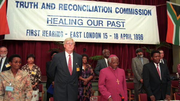 Archbishop Emeritus Desmond Tutu and other members of the Truth and Reconciliation Commission at the first TRC hearing in East London in 1996. (Gallo)