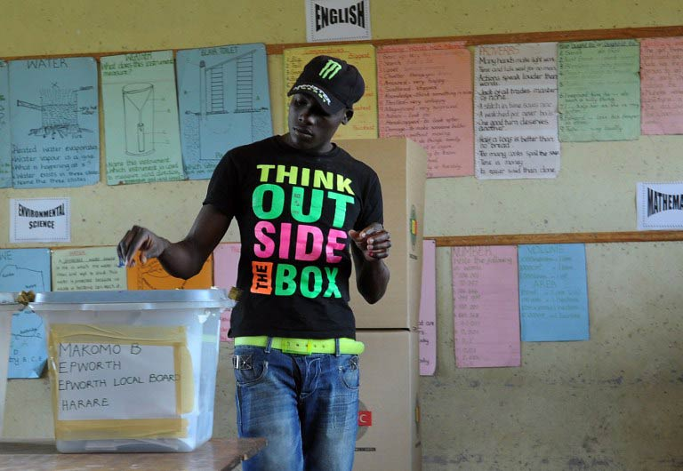 A Zimbabwean casts his vote in Epwath on March 16 2013 during a referendum on a new constitution. (Pic: AFP)