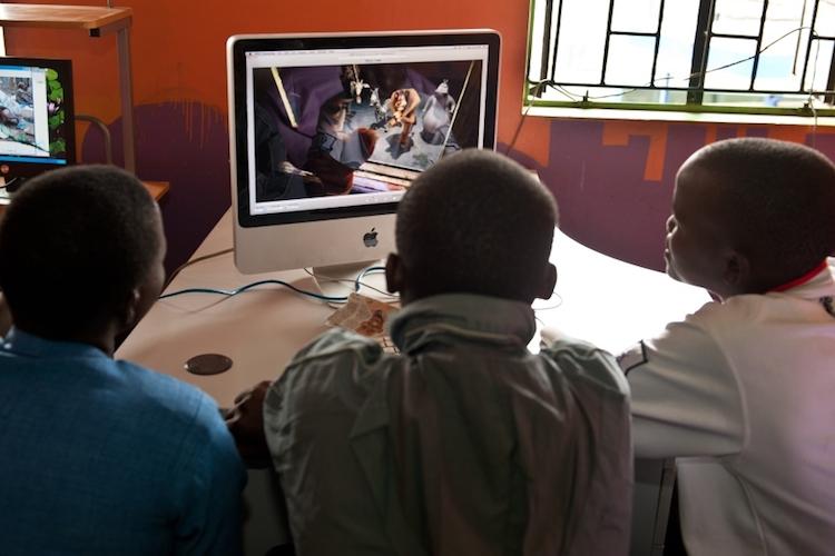 Scholars watch the film Madagascar in the computer lab at Mwelu Foundation in Mathare slum, Nairobi, Kenya. (Pic: Supplied)