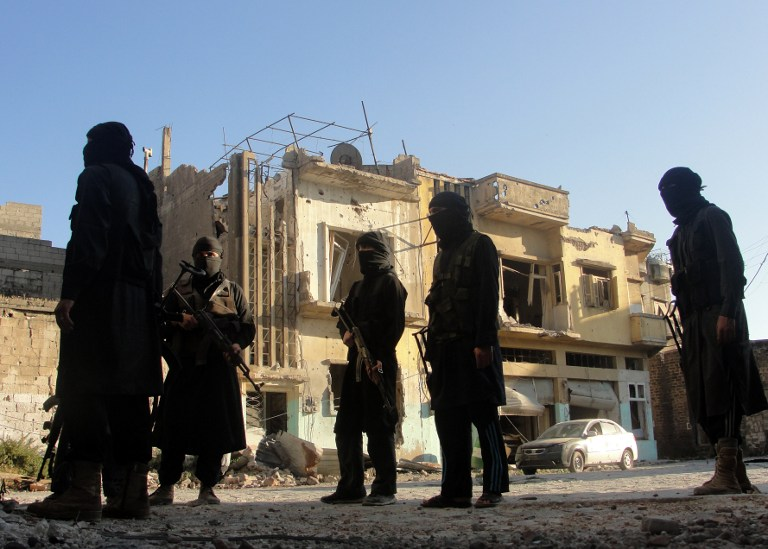 Rebel fighters scouting in the Syrian city of Homs. (Pic: AFP)