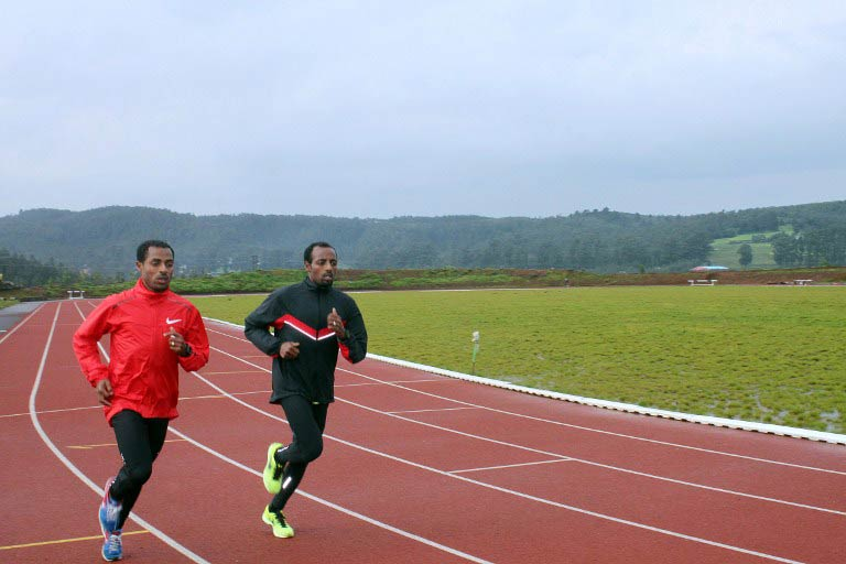 Ethiopian running greats Kenenisa Bekele (L) and his brother Tariku Bekele train at Kenenisa camp in Sululta outside  Addis Ababa on September 1 2013. (Pic: AFP)