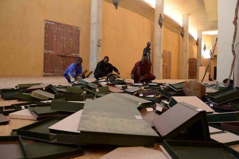 People look through ancient manuscripts at the Ahmed Baba Centre for Documentation and Research in Timbuktu after Islamists torched the building. (Pic: AFP)
