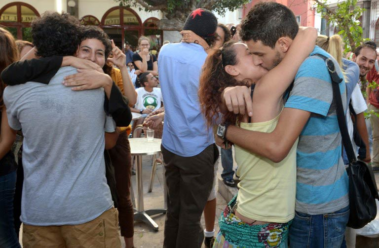 "Participants take part in a ""kiss-in"" outside the Parliament in the Moroccan capital Rabat on October 12 2013. (Pic: AFP)"