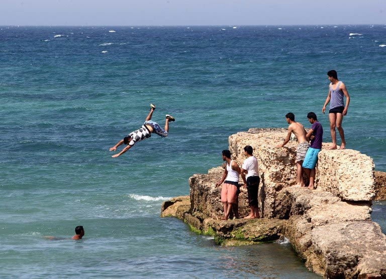 Young Libyans in the Mediterranean Sea off the coast of Tripoli. (Pic: AFP)