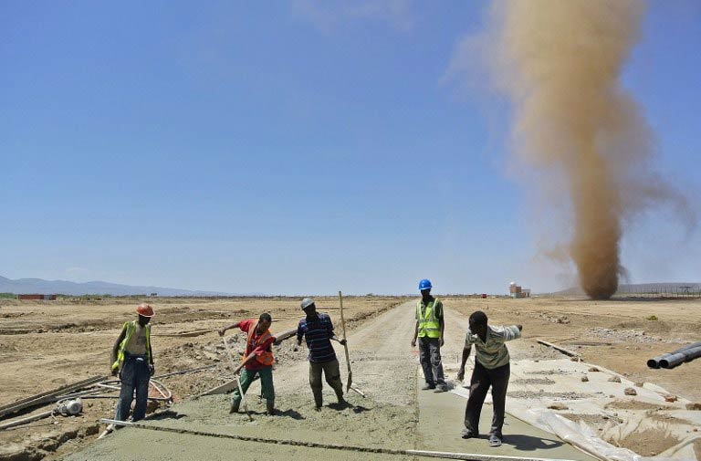 Workers of the Ethiopian Railways Corporation work at a construction site for a new Chinese-built railway in Dire Dawa, north eastern Ethiopia on February 26 2013. The railway will connect Addis Ababa to Djibouti's Red Sea Port at a cost of $2.8-billion. (Pic: AFP)