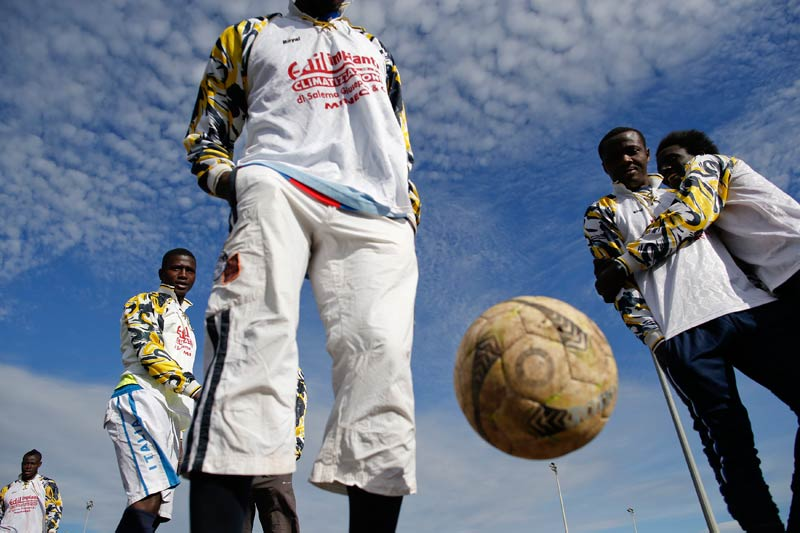 Members of the ASD Mineo soccer team at a training session at the immigration centre in Mineo. (Pic: Reuters)