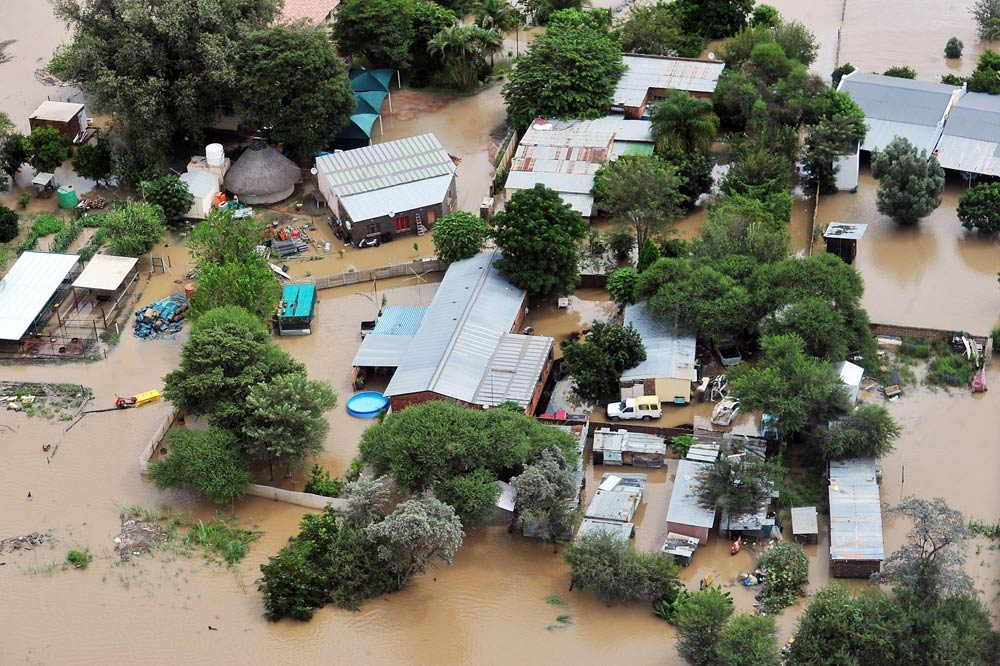 Flooded houses on March 12 2014 in Laphalale, South Africa. Hundreds of residents were left stranded after the Mogol River overspilled due to heavy rains. (Pic: Gallo