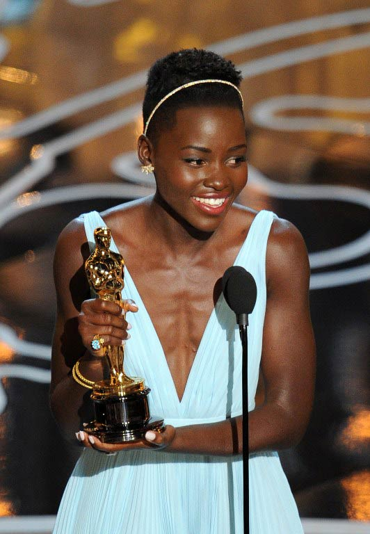 Lupita Nyong'o accepts her best supporting actress Oscar for her role in '12 Years A Slave'. (Pic: AFP)