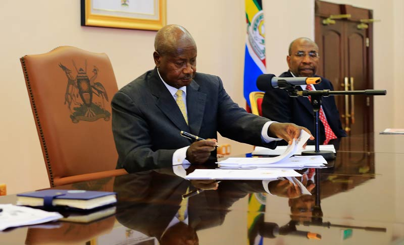Uganda President Yoweri Museveni signs an anti-homosexual bill into law at the state house on February 24 2014. (Pic: Reuters)