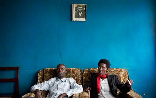 Emmanuel Ndayisaba and Alice Mukarurinda sit in Alice's home in Nyamata, Rwanda. (Pic: AP Exchange)