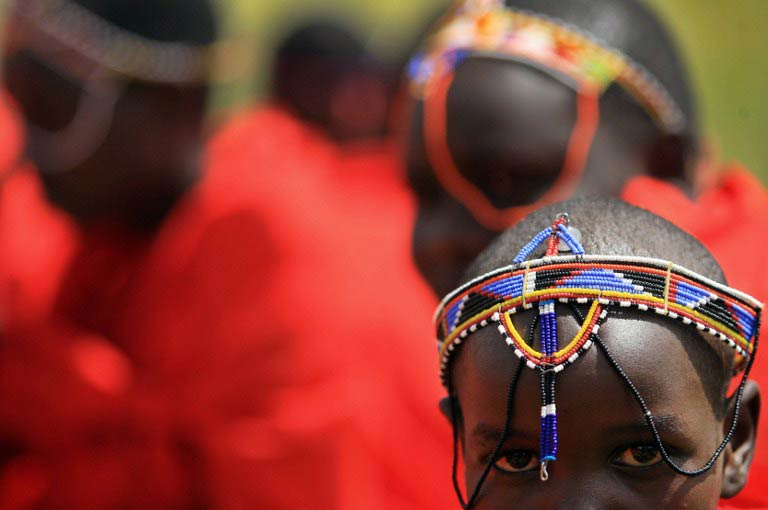 Kenyan teenage Maasai girls attend an alternative right of passage at Kilgoris, Trans Mara district, at a ceremony organised by an anti-female genital mutilation, campaign, Cherish Others Organisation. (Pic: AFP)