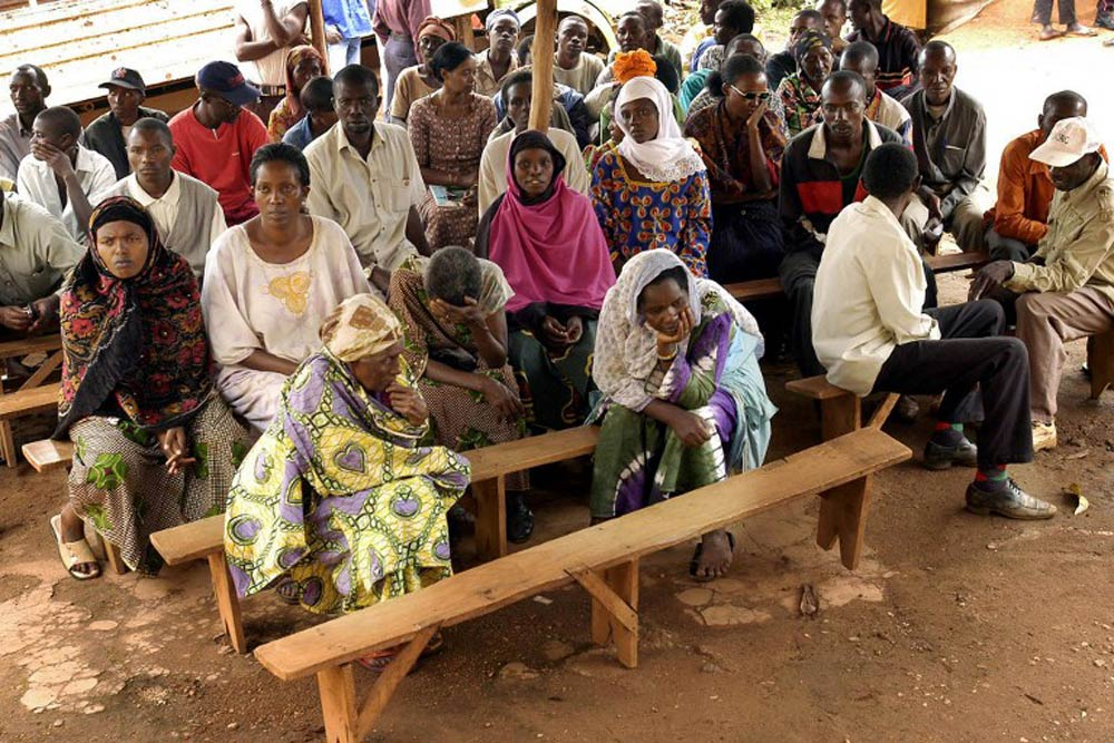 Local people from the Kigali's Gikondo District One attend a session of the Gacaca grassroots tribunal on March 28 2004. (Pic: AFP)