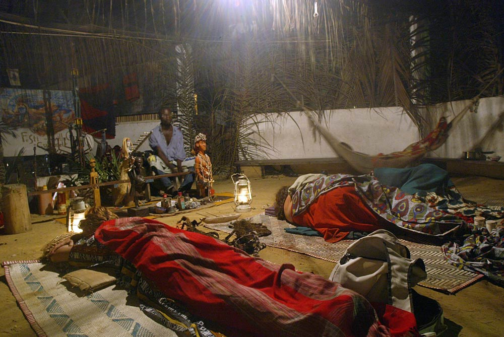 European women rest in a temple after taking iboga during an initiation to the Bwiti rite in September 2005, in Libreville. (Pic: AFP)
