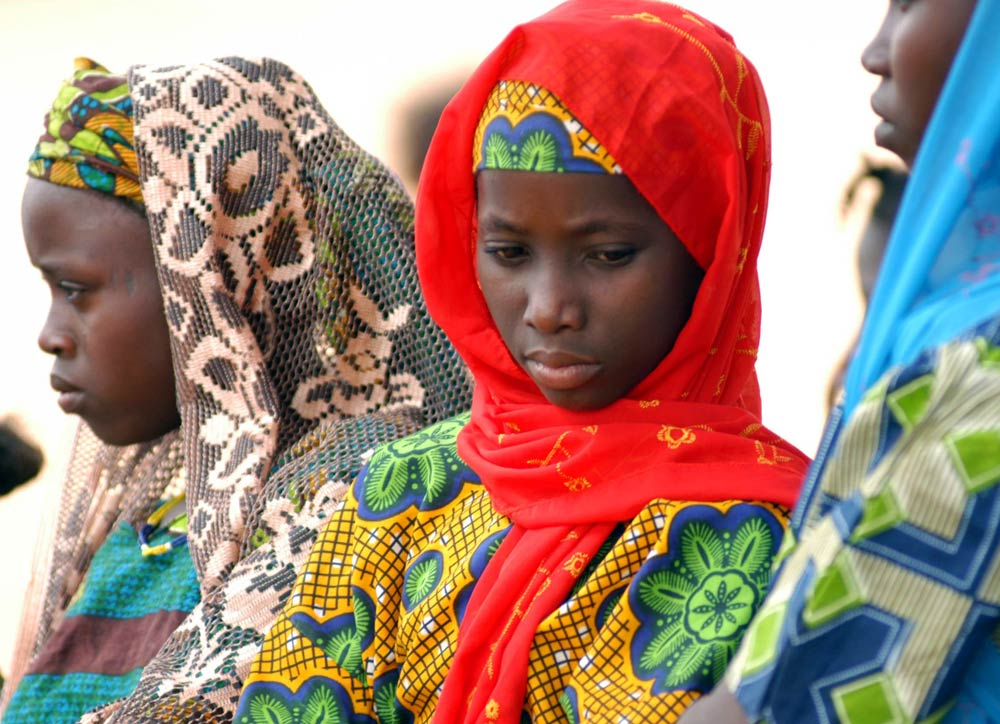 Touareg girls, claimed to be slaves, attend a ceremony where their chief, who had promised to release 7 000 slaves, denied slavery exists. Picture taken March 5 2005. (Reuters)