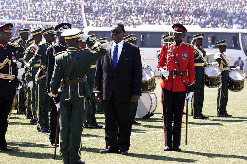 A military officer salutes Peter Mutharika during his official inauguration as Malawi's new President on June 2 2014. (Pic: AFP)
