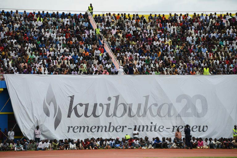 Rwandans gather under a banner at the Amahoro stadium in Kigali on April 7 2014, during a ceremony marking the 20th anniversary of Rwanda's genocide. (Pic: AFP)