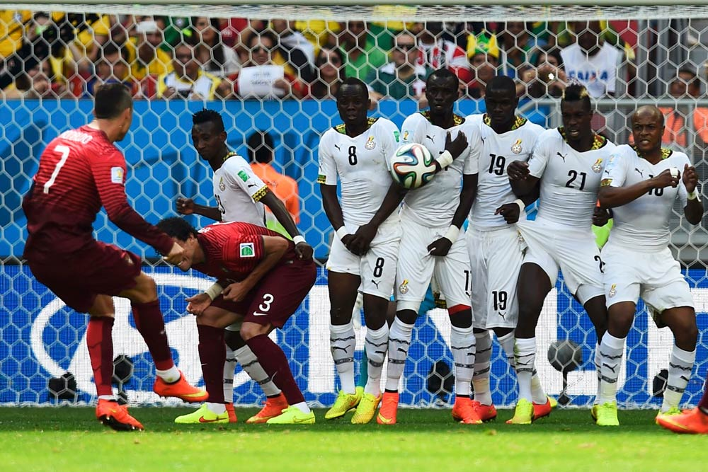 Portugal's Cristiano Ronaldo (L) takes a free kick during the World Cup Group G soccer match against Ghana. (Pic: Reuters)