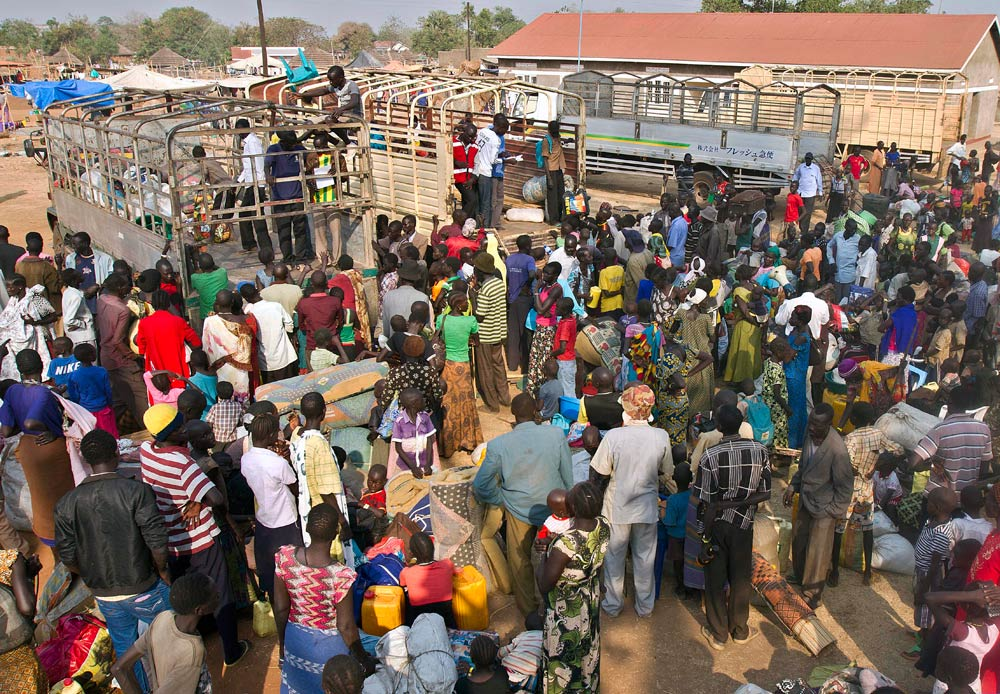 Refugees from South Sudan wait to board trucks to the Nyumanzi Resettlement Camp in Uganda on January 26 2014. (Pic: AFP)