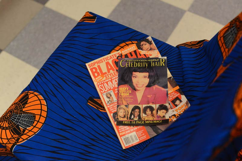Black hair magazines from the 90s, African print fabric from Senegal and linoleum floor tiles are some of the materials that make up Nontsikelelo Mutiti's braiding salon installation. (Pic: Monika Uchiyama)
