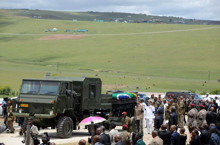 The coffin of Nelson Mandela is carried on a gun carrier for a traditional burial during his funeral in Qunu on December 15 2013. (Pic: AFP)