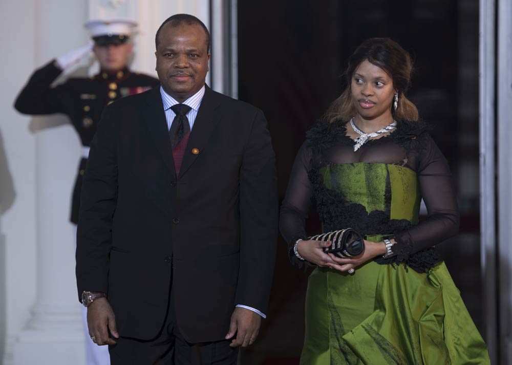 King Mswati III of Swaziland and his wife arrive at the White House for a group dinner during the US Africa Leaders Summit August 5 2014 in Washington, DC. (Pic: AFP)