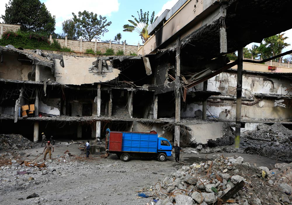 Men work on a damaged section of the Westgate shopping mall  in Nairobi on January 21 2014. (Pic: Reuters)