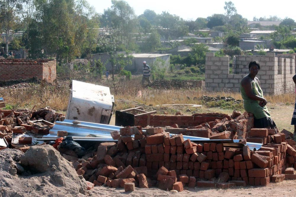 A Chitungwiza resident at what used to be her home. (Pic: Kumbirai Mafunda)