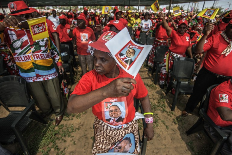 Mozambican Liberation Front (FRELIMO) presidential candidate Filipe Nyusi supporters cheer during the FRELIMO