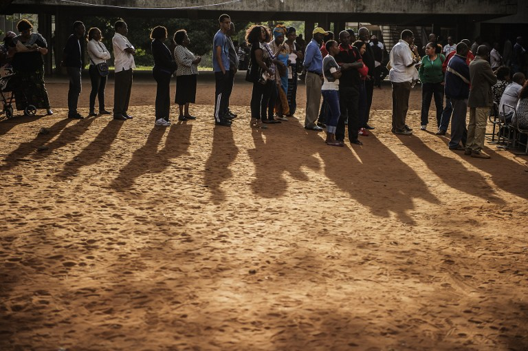 Mozambicans queue outside a polling station in Maputo to vote in presidential and legislative elections on October 15 2014. (Pic: AFP)