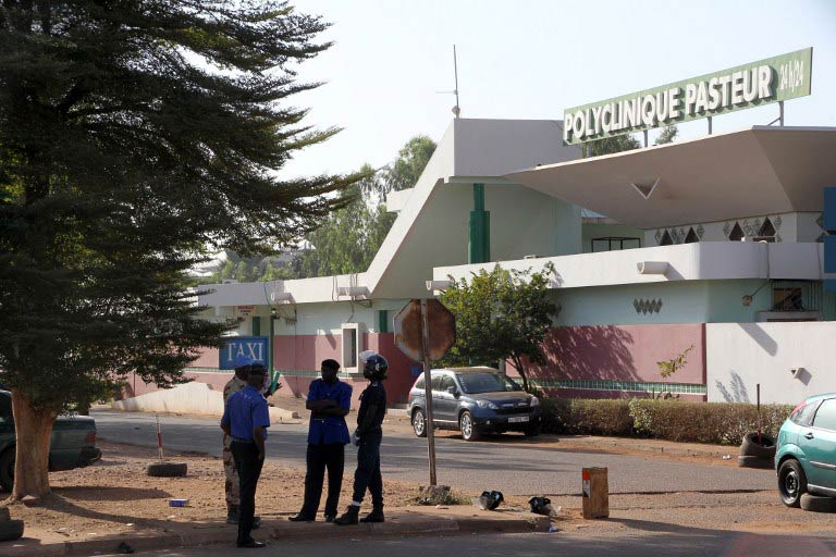 Police officers stand in front of the quarantined Pasteur clinic in Bamako on November 12 2014. (Pic: AFP)