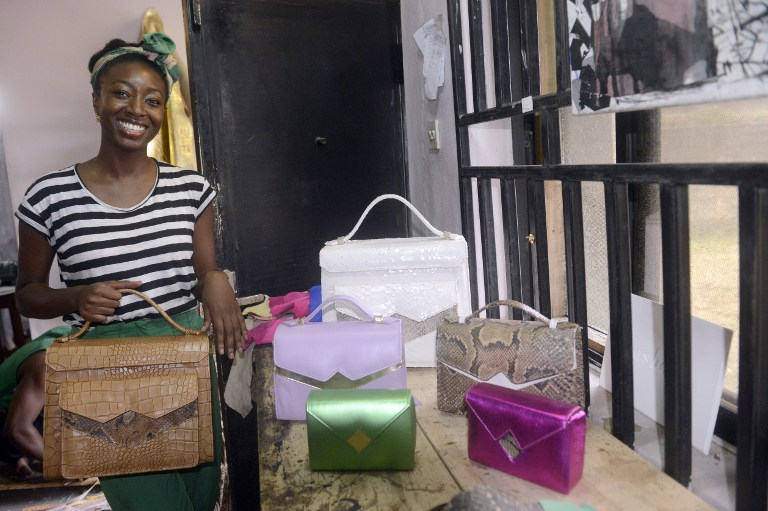 Zainab Ashadu poses with her creations at her workshop in Lagos. (Pic: AFP)