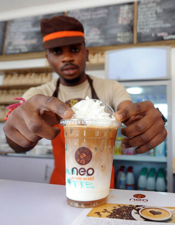 A Cafe Neo steward prepares iced coffee for a customer. (Pic: AFP)