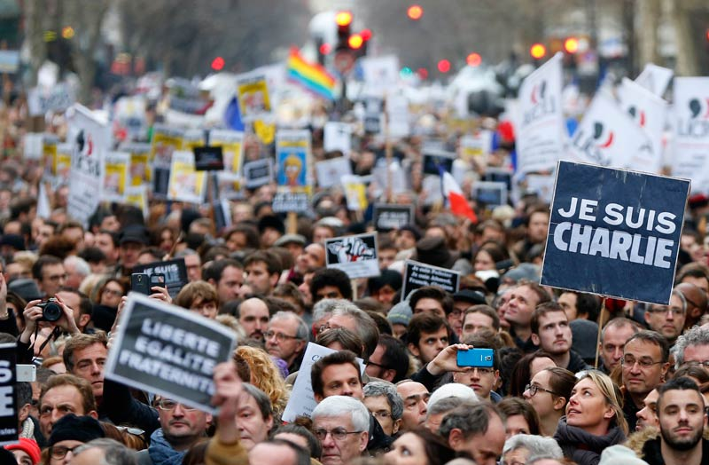 "People hold placards which read ""I am Charlie"" as they take part in a solidarity march  in the streets of Paris on January 11 2015. (Pic: Reuters)"