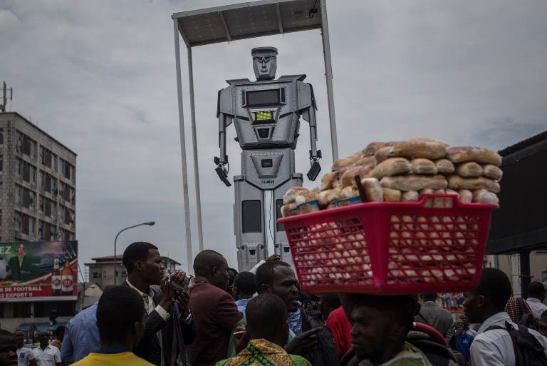 One of three new human-like robots that were recently installed in Kinshasa to help tackle the hectic traffic usually experienced in the capital. (Pic: AFP)