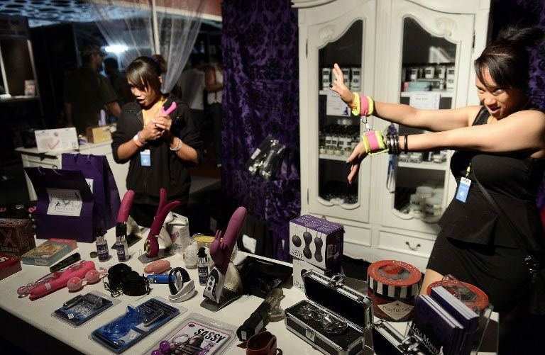 Vendors display sex toys at the 2013 Sexpo sexuality and lifestyle show in Johannesburg. (Pic: AFP)