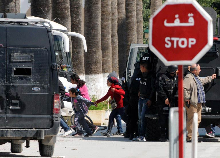 Tourists are evacuated by special forces from the site of an attack carried out by two gunmen at the famed Bardo Museum. (Pic: AFP)