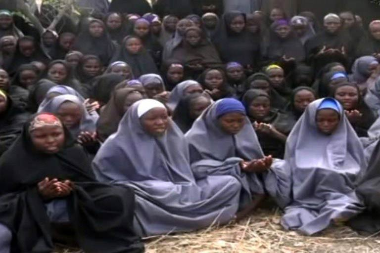 A file screengrab taken on May 12 2014, from a video of Boko Haram obtained by AFP, shows girls wearing the full-length hijab and praying in an undisclosed rural location. (Pic: AFP)