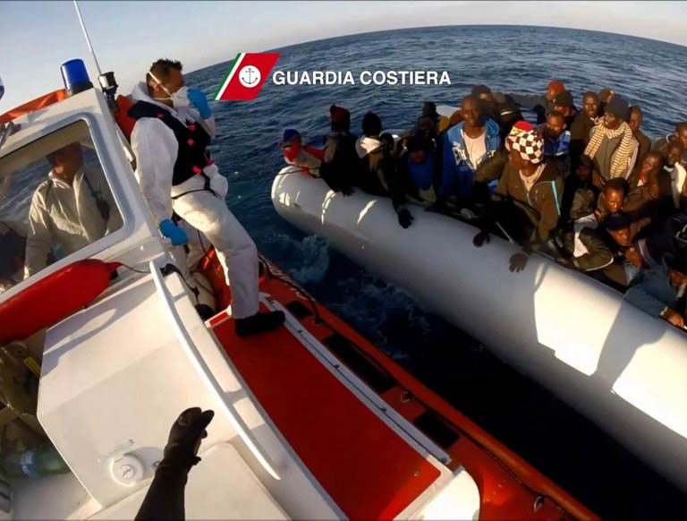 Migrants wait in a boat during a rescue operation on April 15 2015 off the coast of Sicily. (Pic: AFP / Handout)