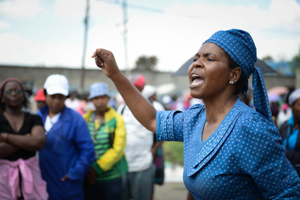 'Mareitumetse Mokhoro addresses workers outside a textile factory in Maseru. (Pic: Meri Hyöky)