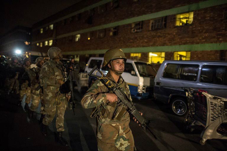 South African soldiers deployed overnight to tackle gangs hunting down and killing foreigners after at least seven people died in a wave of anti-immigrant violence. (Pic: AFP)