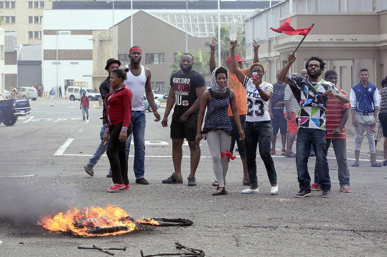 Foreign nationals gesture after clashes broke out between a group of locals and police in Durban on April 14  2015 in ongoing violence against foreign nationals in the city. (Pic: AFP)