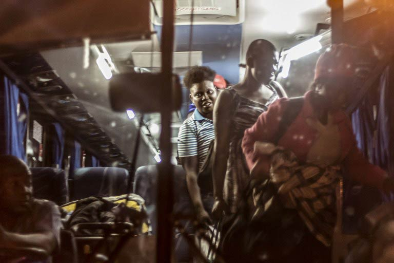 Zimbabwe migrants disembark from a bus on arrival at the International Organisation for Migration Reception and Support Centre in Beitbridge on April 20 2015. (Pic: AFP)
